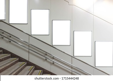 Blank signboard in staircase down to metro station