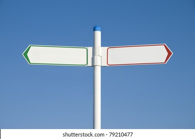 Blank signpost or road sign showing green arrow to the left and red arrow to the right. Environmental concept image.