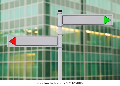 Blank signs on office building background