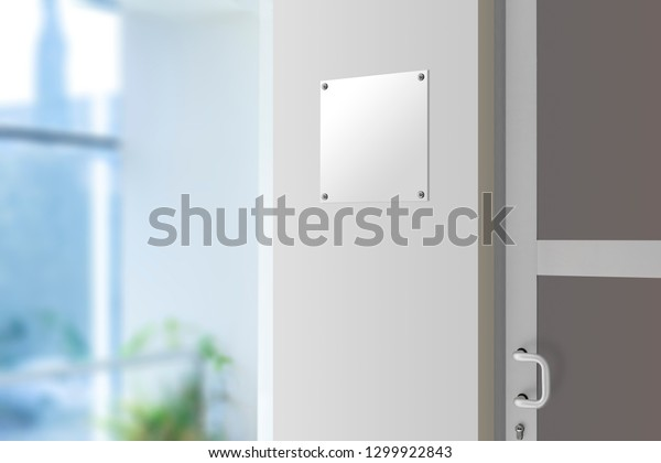 Blank silver sign plate on the wall next to the door, office navigation
