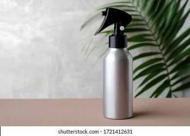 Blank silver trigger hair spray bottle. Natural organic cosmetic for hair salon concept.
