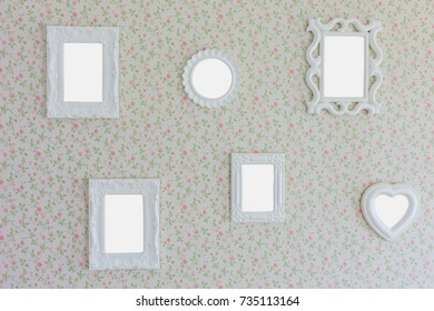 Blank six photo frame on wall background  in the interior.