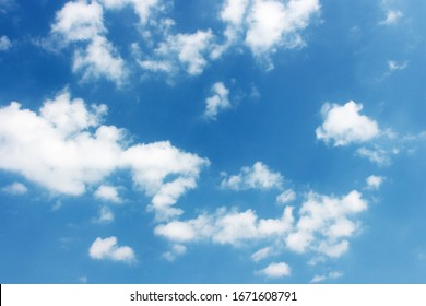 Blank sky surface with small clouds
