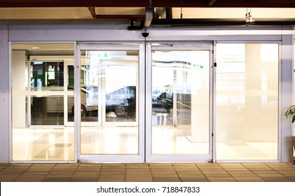Blank sliding glass doors entrance at airport.Glass doors in an office