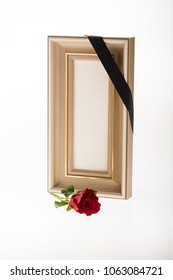 blank slim mourning frame with red rose and black ribbon on bright background for condolence card