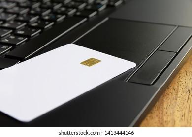 Blank smartcard on keyboard of laptop computer