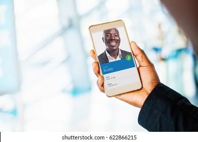blank smartphone screen. dark skin hand holding a phone