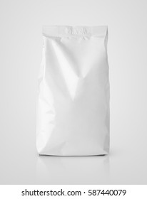 Blank snack white paper bag package on gray. Plastic packaging with clipping path