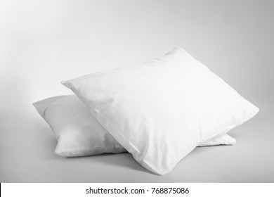 Blank soft pillows on light background