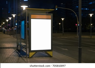 Blank space for advertisement at a bus stop. Lightbox mock-up at night. Horizontal.