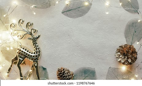 blank space, dry leaves and light Christmas decoration for background