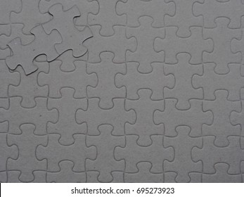 Blank space gray jigsaw puzzle as a copy space background
