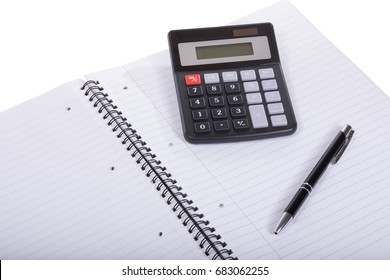 Blank spiral bound notebook with pen and calculator in a close up view conceptual of business accounting, planning or analysis of of college education