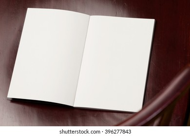 Blank spread, open book on old wooden table.
