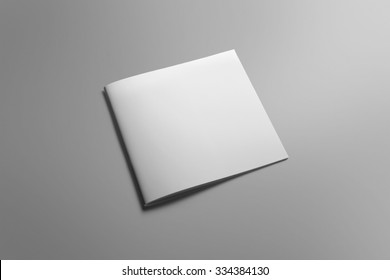 Blank square brochure magazine isolated on grey, with clipping path, changeable background