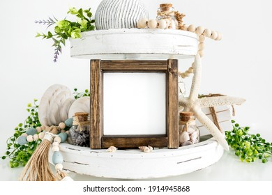 Blank square rustic wood sign on tier tray with beach decor, farmhouse style mockup - Shutterstock ID 1914945868