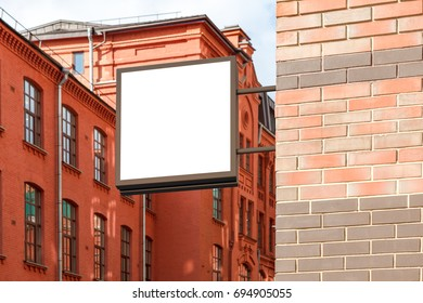 Blank square signboard on the brick wall. 3d illustration
