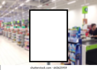 Blank standing sign with copy space for text message or mock up content in abstract Blur row of cashier counter checkout in the supermarket.