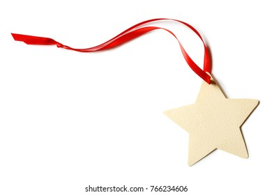 Blank, star-shaped Christmas gift tag with red ribbon isolated o