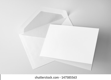 Blank stationery: card and envelope over grey background with shadow