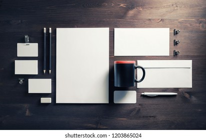 Blank stationery and corporate identity template on wood background. Responsive design mockup. Top view. Flat lay.