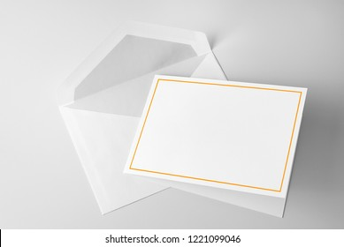 Blank stationery: greeting card with gold frame and envelope