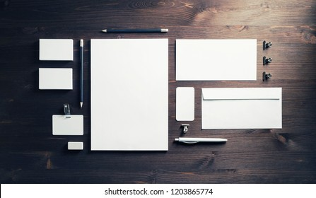 Blank stationery and ID template on wooden background. Mock-up for branding identity for designers. Top view. Flat lay.