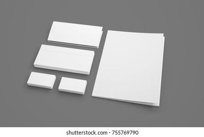 Blank stationery isolated on grey. Envelopes, folder and cards to showcase your presentation.