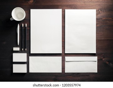 Blank stationery on wooden background. ID template. Mock-up for branding identity for designers. Top view. Flat lay.