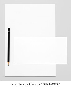 Blank stationery: paper, envelope, and pencil