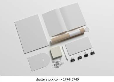 Blank stationery set isolated on white. Consist of folder, note, magazine, business cards, penl, cd disk, buttons, envelopes, tubus.