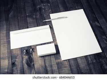 Blank stationery set on vintage wood background. Letterhead, business cards, envelope and pen. Mock up for branding identity. Blank ID template.