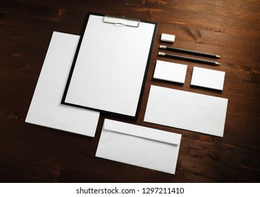 Blank stationery set on wood table background. ID template. Mockup for branding identity for designers.