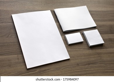Blank stationery set on wood background / a4 paper, business cards, booklet, sheets, etc