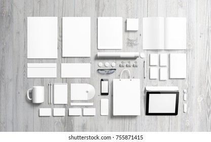 Blank stationery set on wooden background. Branding set to showcase your presentation. Top view.