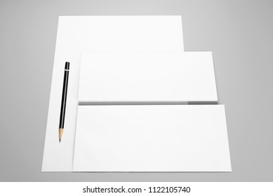 Blank stationery: sheet of paper, two envelopes, and pencil