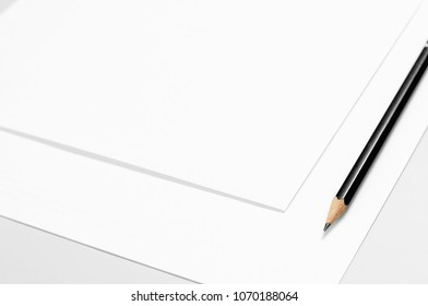 Blank stationery: sheets of paper and pencil