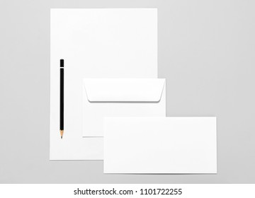 Blank stationery: sheets of paper, pencil and two envelopes
