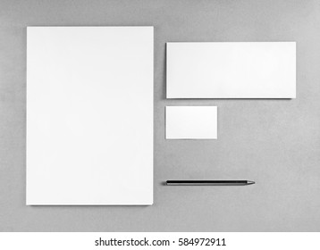 Blank stationery template for placing your design. Photo of blank stationery set. Blank letterhead, business cards, envelope and pencil. Mockup for branding identity. Top view. Grayscale image.