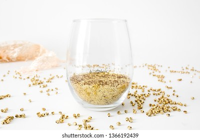 Blank stemless wine glass with gold glitter, party mock up