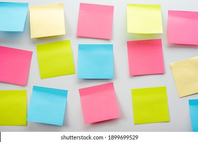 Blank Sticker notes on the white background. Mockup sticky Note Paper. Business people meeting and use post it notes to share idea on sticky note.Discussing business, teamwork, brainstorming concept
