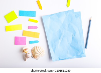 Blank sticky notes with different colors and shapes.