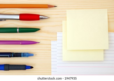 blank sticky notes and pens
