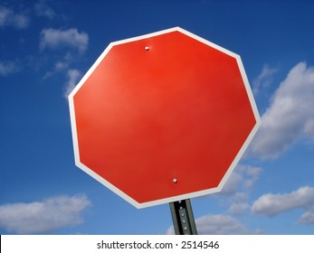 Blank stop sign frame against blue sky.