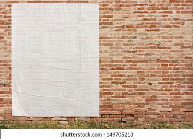 blank street advertising billboard stuck on brick wall