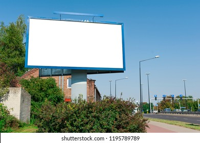 Blank street billboard for advertisement in a sunny day.