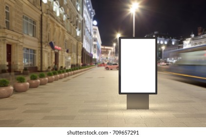 Blank street billboard at night city. Isolated with clipping path around advertising display. 3d illustration.