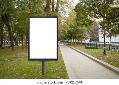 Blank street billboard poster stand in urban park. 3d illustration.