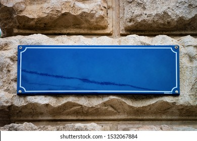 Blank Street plate on building wall of Vienna in Austria. Empty name sign board on house in Innere Stadt in Wiena. Place for copy space. Concept and architecture. Texture and background. Blue color - Shutterstock ID 1532067884