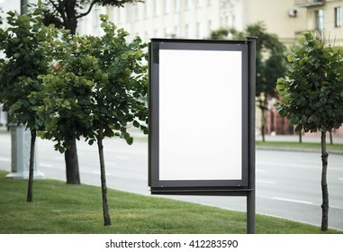 Blank street poster. Blank billboard on the city street. Isolated with clipping path. Shallow depth of field. Selective focus.